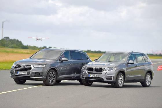 Немецкое противостояние: BMW X5 II против Audi Q7 I