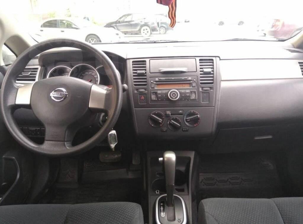 Обзор Nissan Tiida I: за что можно любить переростка